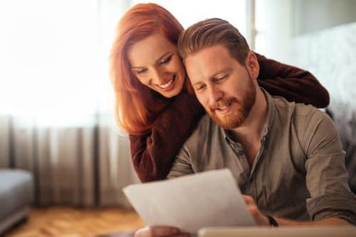 Happy Couple reading documents