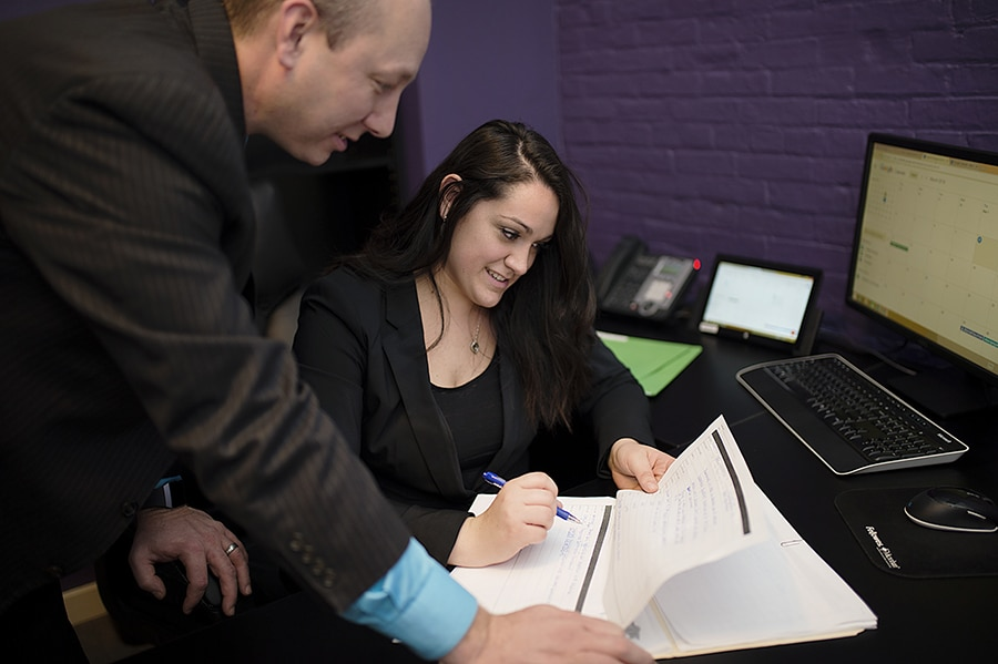 Attorneys reviewing documentation