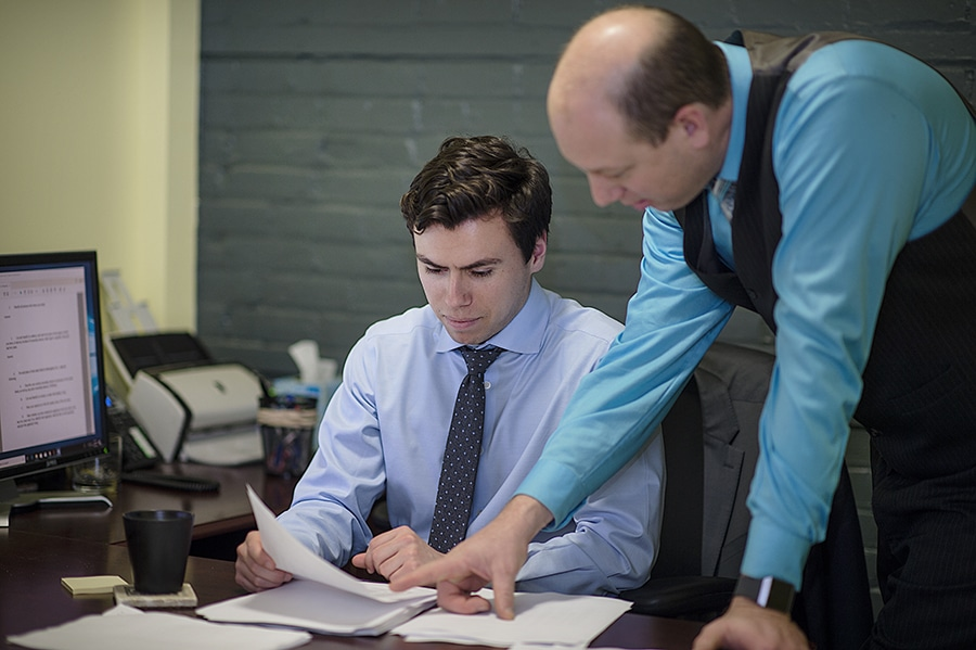 Attorneys reviewing documents